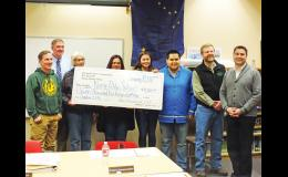 DONATION— Sitnasuak Native Corporation presented a check to Nome Public Schools last week at the school board meeting.