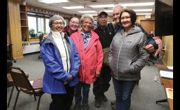 HONORING AN EDUCATOR— Josie Bourdon, center, was surrounded by family (left to right) Mary David, Kayla Bourdon, Wilson Bourdon, Jay David and Katie Bourdon in Council Chambers at City Hall on Monday June 14 after receiving a recognition by the Alaska State Legislature.