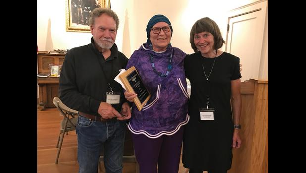 AWARD— Local historian Cussy Kauer, center, was presented with the Contributions to Alaska History Award by Michael Hawfield, left, and Joan Antonson, right, Director of the Alaska Historical Society during the Awards Banquet after the joint Museums Alaska and Alaska Historical Society conference in Nome