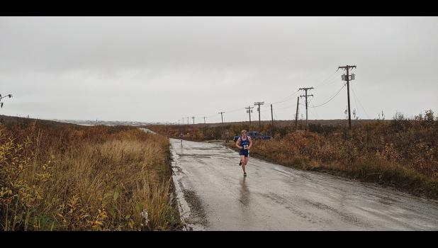 WINNER—Son Erikson on his way to win Kotzebue XC event held last weekend, with Orson Hoogendorn in pursuit.