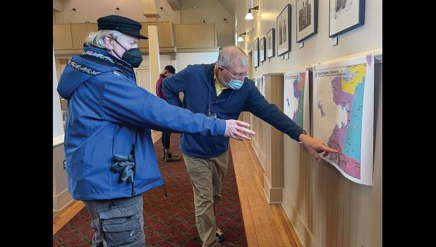 Nomeite Lew Tobin, left, discusses a map proposal with Redistricting Board member Budd Simpson, during Monday's public meeting at Old St. Joe's.