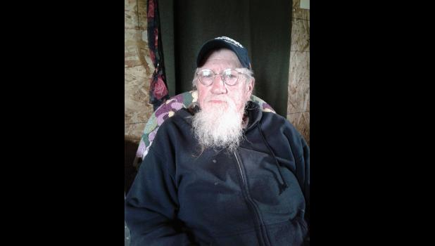 SURVIVED— Richard Jessee survived a bear attack near his mining claim camp, was stalked by the bear for several days and managed to give a distress signal to a Coast Guard helicopter passing by.