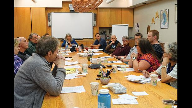 HOUSING CRISIS— Nate Richmond with BlueLine Development, center next to Sue Steinacher and Mayor Richard Beneville, listened to Nome community leaders' discussion of the shortage of low-income rentals in town. He helped to brainstorm solutions during the meeting on July 18.