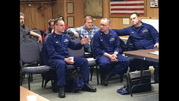 """TALKING IT OVER—District 17 U.S. Coast Guard personnel came to Nome to meet with dredge operators who say this season's enforcement of USCG existing safety regulations will cost lots of money and should not apply to the fleet of """"unique"""" mining dredges. Left to right are Commander Justin Jacobs, Lt. Commander Mason Wilcox, Commander Christopher Coutu."""