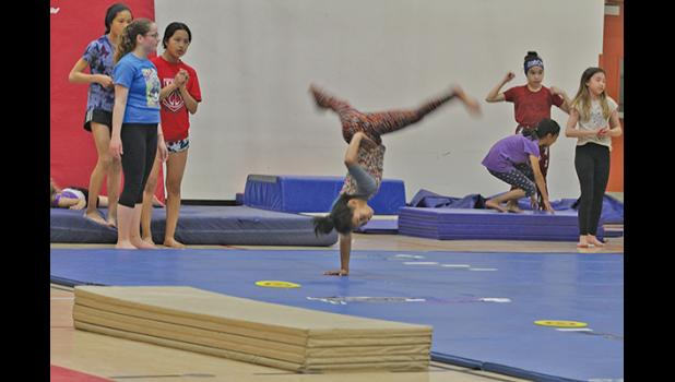 ONE HANDED— Jocelyn Takak effortlessly spins a one-handed cartwheel at the last day of gymnastics camp, which was an intensive, five-day camp coached by a gymnast from Fairbanks and organiser Chelsea Hubert.