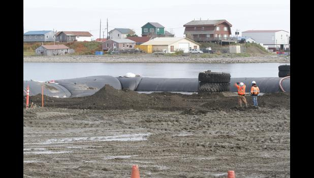 BARGE RAMP REPAIR— Repairs of the launch ramp replacement hit a snag due to stormy weather, making it difficult to de-water the area to replace the concrete barge ramp. With the help of the pictured 'aqua dam' project contractors hope to achieve the de-watering to allow the installation of the concrete ramp