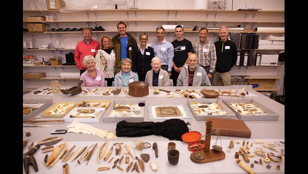 DONATION TO THE MUSEUM— Descendants of Tom and Ellen Lopp donated a trove of artifacts that were collected by the Lopps while in Wales around the turn of the 19th century. They posed before much of the collection for a group photo Saturday at the Carrie M. McLain Memorial Museum.