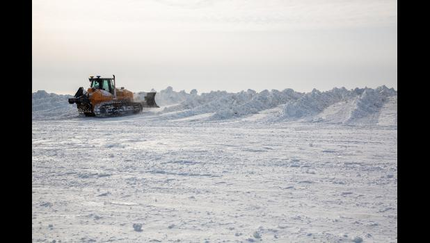 HEAPS OF SNOW— The city's snowdump fills up with lots of snow removed from Nome's streets.