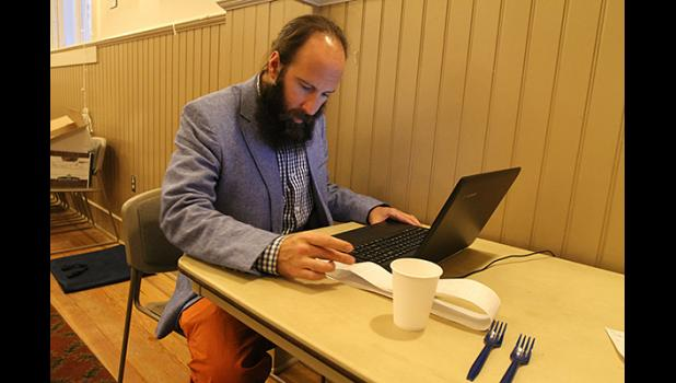 City Clerk Bryant Hammond tallies the votes in last Tuesday's municipal election.