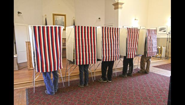 Nome voters cast their ballots in voting stations at Old St. Joe's Hall, on election day, Nov. 8, 2016.