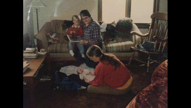 SHE LOVED KIDS— Nancy McGuire holds young Andy Lean while Mikey Lean tends to baby Reba.
