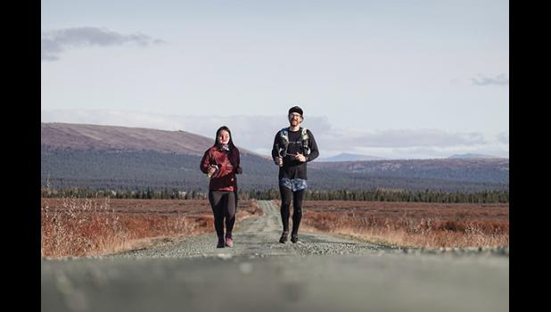 THE LONG ROAD—Carol Seppilu and Tim LeMaire run the long and lonesome road from Council on their way to Nome on Sept. 26.