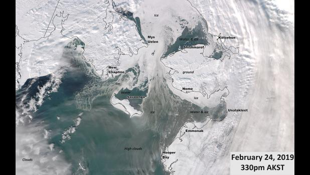 BLUE WHERE IT SHOULD BE WHITE— This satellite photo, taken on Sunday, Feb. 24,  reveals a shocking lack of sea ice in the Bering Sea. The open water is connected to the blizzards hammering the region.