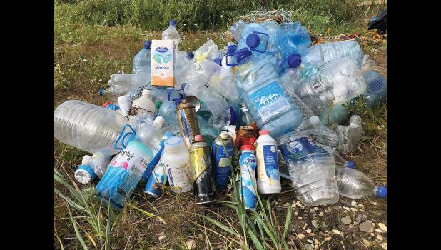 HEAPS OF PLASTIC TRASH— An unusual amount of plastic trash has been found washing ashore in the region, from as far north as Shishmnaref to Unalakleet. Most of the labels are in Russian or Korean languages.