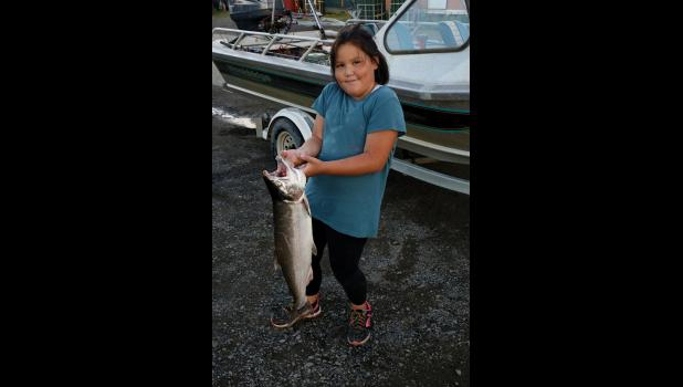 ONE BIG FISH — Lily Lausten Katongan poses with her winning 9.8-pounder. She tied for first place with Cedar Busk.