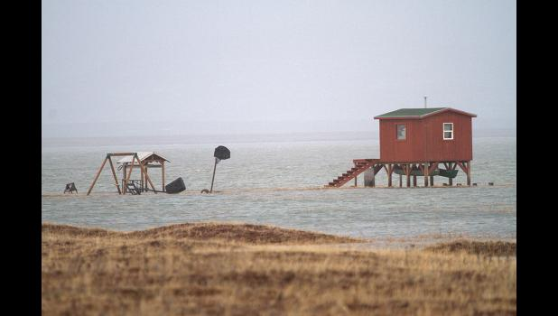 UNDER WATER— Storm surges flooded subsistence camps along Safety Sound, roads and other infrastructure in the region.