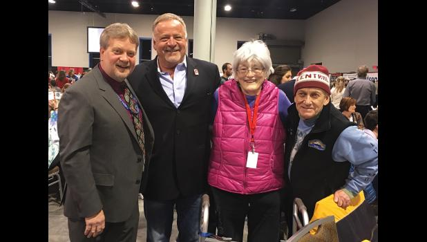 Nancy McGuire is pictured with (left to right) John Handeland, Iditarod executive director Stan Hooley and Nome Mayor Richard Beneville during the 2016 Iditarod banquet in Anchorage