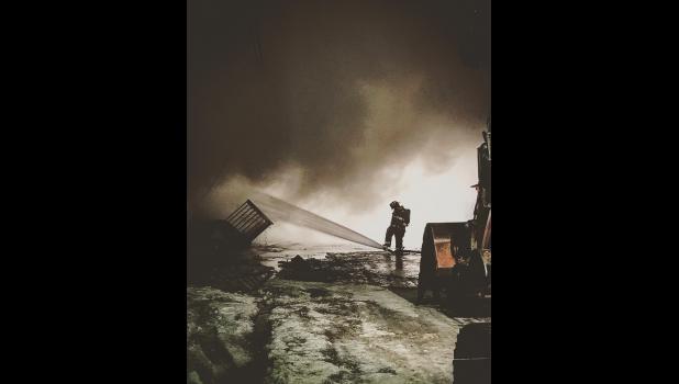 FIGHTING THE FLAMES— A NVFD volunteer battles the Polaris fire last week.