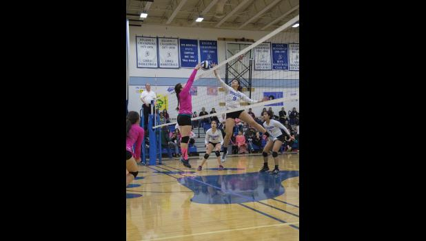 JOUST—Nome-Beltz Nanooks junior Katherine Scott, left, and Barrow Whalers junior Crystalynn Tulai meet at the net during the Arctic Pinkies Volleyball Tournament in the Nome-Beltz gym on Friday night.