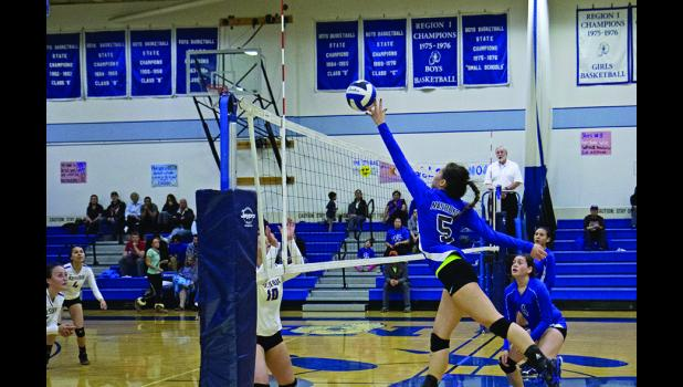 GRATUITY— Nome-Beltz senior volleyball player Megan Contreras delivers a well-placed tip against Kotzebue on Saturday morning. The Nanooks opened their home schedule last weekend with a split in their pair of games against the Huskies.