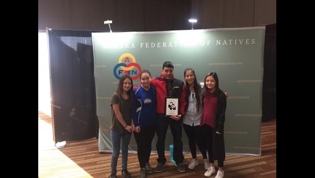 PARENT OF THE YEAR— Nome's Buddy Okleasik, surrounded by his daughters Grace, Zoe, Ivory and Heidi, shows the Parent of the Year plaque he was awarded during last week's AFN convention in Anchorage.