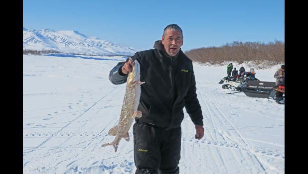 PIKE FISH DERBY— Keith McDaniel shows off his catch during last Saturday's third annual Pike Fish Derby