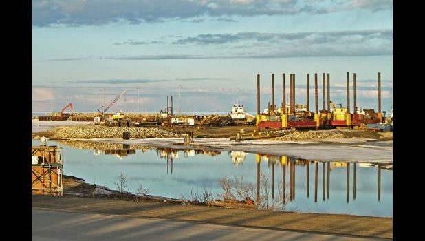 THAR SHE FLOWS— Big dreams riding big offshore mining dredges wait for the moment the Snake River knocks the ice out of the harbor. Phoenix Marine had them lined up with equipment in place to push and pull them into the water in anticipation of an early breakout.