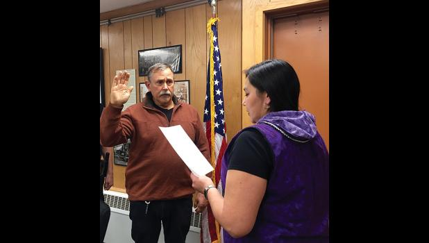 NVESTIGATOR— Detective Michael Heintzelman has taken a temporary full-time job with Nome Police Dept. as a full-time investigator to help clear a backlog of cases. Here, Christine Piscoya, deputy city clerk, administers Heintzelman's oath of office.
