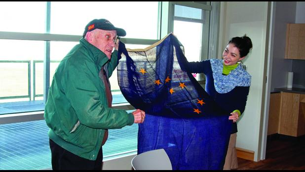 FIELD OF BLUE—Mayor Richard Beneville and Director Amy Phillips-Chan of Carrie M. McLain Memorial Museum show an antique Alaska flag that Beneville brought to the April 20 meeting of the Nome Museum and Library Commission.