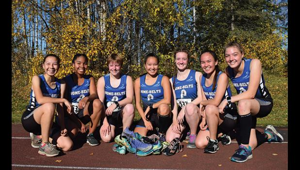 REGIONAL CHAMPS—  Nome Girls XC Team celebrates after the State meet in Anchorage last weekend. They are (left to right) Alicyn Bahnke,  Daynon Medlin, Starr Erikson,  Mallory Conger,  Ava Earthman,  Katelyn Tocktoo and Bethany Daniel.