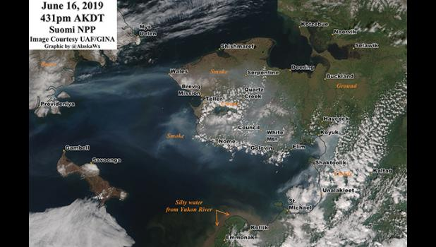 SMOKY— This satellite image taken on Sunday shows smoke-filled skies over much of the Seward Peninsula