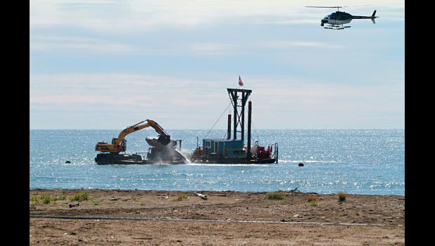 GOING BIG— The Pomrenkes' gold dredge Christine Rose is digging for gold off Nome's beaches, as a film crew in the helicopter is filming the action in this file photo from 2011.