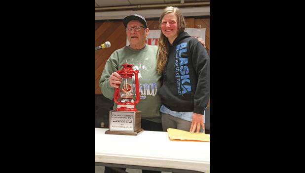 RED LANTERN— Nome's Howard Farley presented the Red Lantern to Victoria Hardwick of Bethel, during the Red Lantern Banquet on Monday, March 18.
