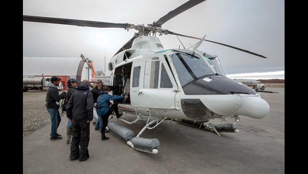 ALL  ABOARD— Passengers for Diomede board the Pathfinder helicopter on Monday, Oct. 22 at the Nome Airport.