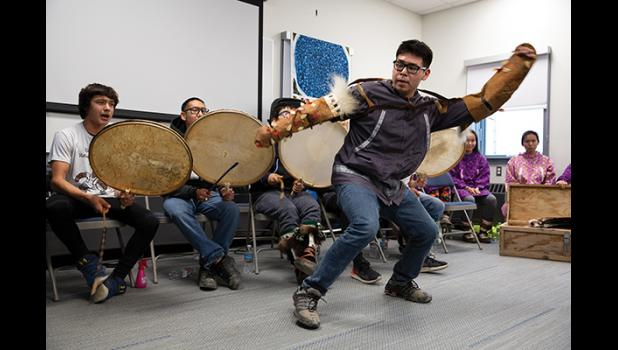 CELEBRATING—Eddie Kakaruk with the King Island drummers and dancers helped celebrate the commemoration of new UAF Northwest Campus buildings.