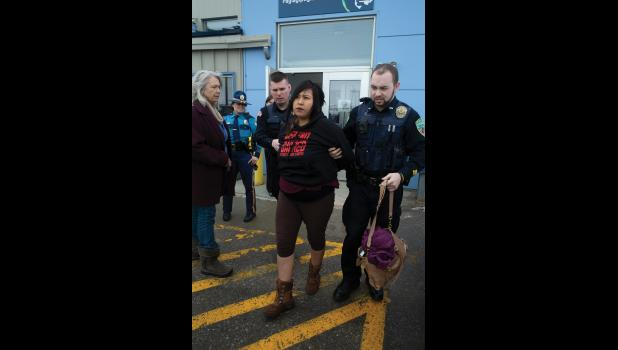 Brenda Evak being arrested for disorderly conduct, at the Alaska Airlines terminal in Nome, on March 27, 2019.