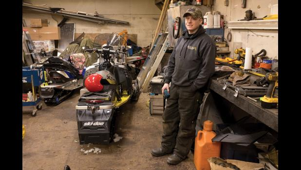 READY—The wrenching is done and Tre West is ready for Sunday's start of the 2018 Iron Dog snowmachine race