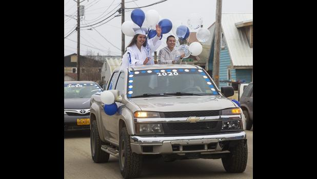 PARADE— NPSExtensions Correspondence School graduate Celina Nadie Habros waves to well-wishers as the graduation parade winds through Nome.