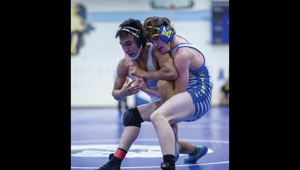 OUTSTANDING WRESTLER—Elden Cross wrestles his Kotzebue opponent in the 145-lbs championship match Saturday, which he won, during the Regional Wrestling Tournament, held in Nome last weekend. Cross was named Outstanding Wrestler.