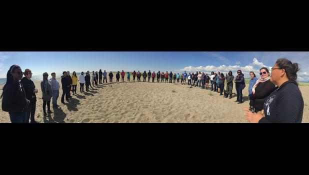 THE CIRCLE –Truth, Racial Healing and Transformation leaders form a circle in Solomon during their visit Wednesday.