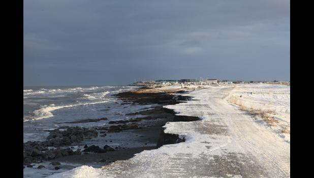 EROSION— The road that connects the village of Shishmaref to its landfill has been damaged and washed away by last week's storm surge. Without protective shore ice, fall storms continue to erode Sarichef Island.