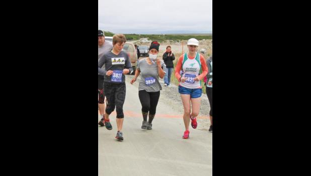 FIRST HALF MARATHON— Carol Seppilu, center, with bib nr. 3834, at the start line of her first half-marathon race at Cape Nome in July 2016. Since then she has finished several long distance races.