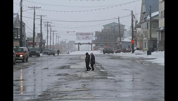 "Nome's Front Street is nearly empty, on Friday afternoon, when in ""normal"" years many visitors stroll down Front Street."
