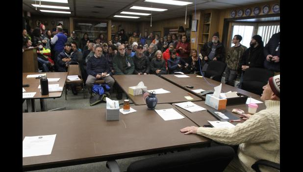 Mayor Beneville addresses the crowd gathered for a special council meeting on Covid-19 on Thursday, March 12.