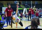 REACHING HIGH— Ivory Okleasik competes in the One Hand Reach during the State Native Youth Olympics in Anchorage.