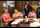 MK Romberg, Caroline Muktoyuk-Brown and Loretta Bullard share a laugh at the crocheting table at the Fiber Fest.