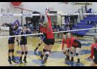 NOME WINS— The Nome-Beltz Lady Nanooks volleyball team won two matches against the Juneau-Douglas Crimson Bears, last weekend, in Nome. Pictured is Juneau's Abby Meiners hitting the ball as Nome's Annalise Contreras, Emily Pomrenke stand ready at the net in defense.