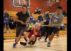 NYO WRIST CARRY— Paris Hebel hangs on while Nate Cushman, left, and Elden Cross run him around the perimeter of the gym in the Wrist Carry event during last weekend's NYOExtravaganza in Nome.